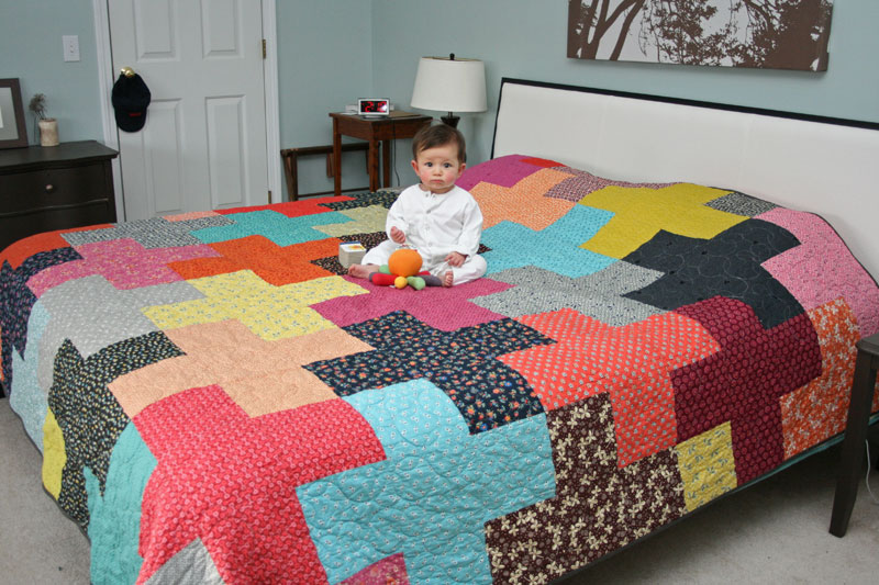 a giant plus quilt for the bed
